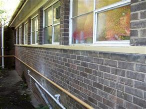 Rebuilt and coated windowsill for long-term protection from concrete spalling