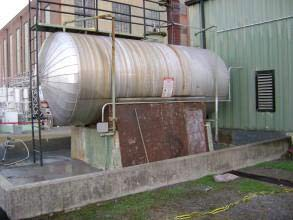 Damaged secondary containment area at a power plant